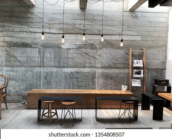 Chiangmai, Thailand; 29 March 2019: Modern cafe interior with a brick wall, a wooden chair, black tables. The interior design of a Coffee shop, cafe.