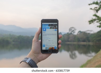 CHIANGMAI, THAILAND -APR 9,2017:Man hand holding smartphone and using Twitter application,Twitter is an online social networking.