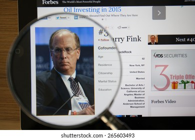 CHIANGMAI, THAILAND - April 1, 2015: Photo of Forbes article page about Laurence D. Fink on a ipad monitor screen through a magnifying glass.