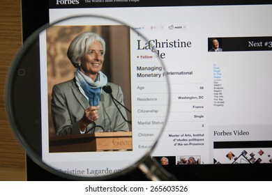 CHIANGMAI, THAILAND - April 1, 2015: Photo of Forbes article page about Christine Lagarde on a ipad monitor screen through a magnifying glass.