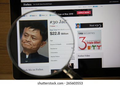 CHIANGMAI, THAILAND - April 1, 2015: Photo of Forbes article page about Jack Ma on a ipad monitor screen through a magnifying glass.