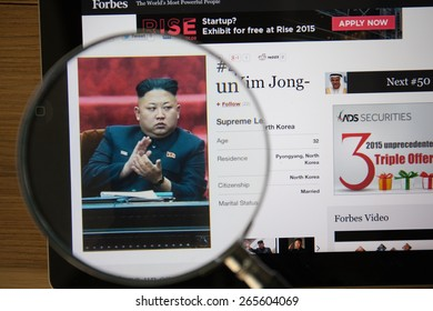 CHIANGMAI, THAILAND - April 1, 2015: Photo of Forbes article page about Kim, Jong-un on a ipad monitor screen through a magnifying glass.