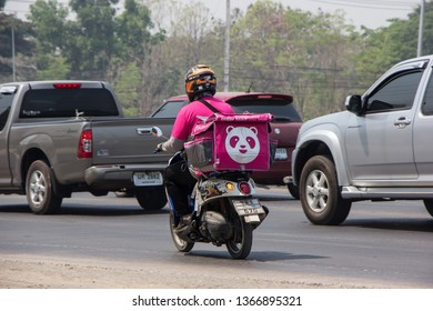 Chiangmai, Thailand - April 11 2019: Delivery service man ride a Motercycle of Food Panda. On road no.1001, 8 km from Chiangmai city.
