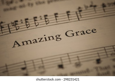 """CHIANGMAI, THAILAND, April 21,2015. Singing The Christian Hymnal book on the song of """" Amazing Grace """" at home. April 21,2015"""