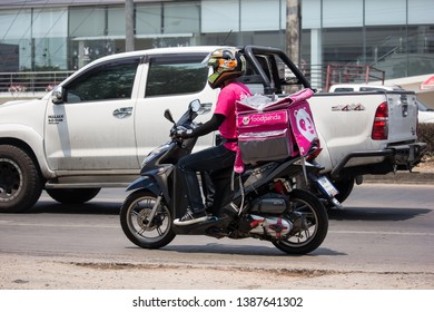 Chiangmai, Thailand - April 30 2019: Delivery service man ride a Motercycle of Food Panda. On road no.1001, 8 km from Chiangmai city.