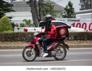 Chiangmai, Thailand - April 30 2019: Delivery service man ride a Motercycle of Pizza Hut Company. On road no.1001, 8 km from Chiangmai city.
