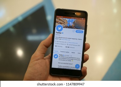 CHIANGMAI, THAILAND -AUG 1,2018:Man hand holding smartphone and using Twitter application,Twitter is an online social networking.