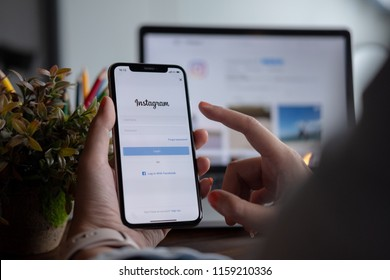 CHIANGMAI, THAILAND - AUG 18,2018 : A woman hand holding iphone with new logo of instagram application. Instagram is largest and most popular photograph social networking.