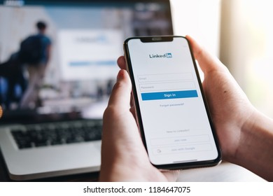 CHIANGMAI, THAILAND - AUG 18,2018 : A women holds Apple iPhone X with LinkedIn application on the screen.LinkedIn is a photo-sharing app for smartphones.
