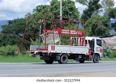 CHIANGMAI, THAILAND -AUGUST 10 2015: Truck with crane of Northern Art Company. Photo at road no.121 about 8 km from downtown Chiangmai, thailand.