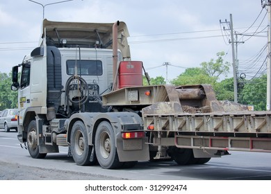CHIANGMAI, THAILAND -AUGUST 13 2015:  Trailer truck for move backhoe of PCN Asphalt Company. Photo at road no.1001 about 8 km from downtown Chiangmai, thailand.