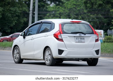 CHIANGMAI, THAILAND -AUGUST 20 2015: Private car, Honda Jazz. Photo at road no.121 about 8 km from downtown Chiangmai, thailand.