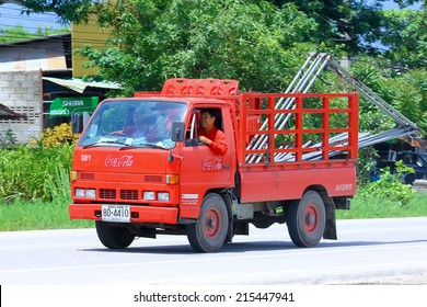 CHIANGMAI , THAILAND - AUGUST 22 2014: Coca Cola Truck (Coke). Photo at road no 121 about 8 km from downtown Chiangmai, thailand.