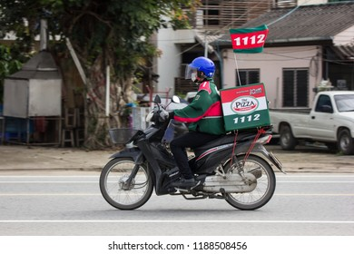 Chiangmai, Thailand - August  23 2018:  Delivery service man ride a Motercycle of The Pizza Company. On road no.1001, 8 km from Chiangmai city.