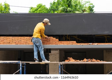 Chiangmai, Thailand - August 23 : Unsafe construction worker in construction site