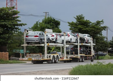Chiangmai, Thailand - August  3 2018: ANI Logistics Group carrier trailer Truck for Honda car.   On road no.1001, 8 km from Chiangmai city.
