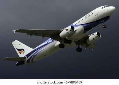 Chiangmai, Thailand. August 30, 2014 Bangkok Airways Airbus A320-200 Reg. HS-PPK Taking Off from Chiangmai International Airport with Rain Cloud Background.