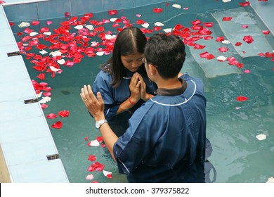 CHIANGMAI, THAILAND - AUGUST 8, 2015 : Ceremony of baptism. Christians make baptism in water pond at Chiangmai Fellowship Church in Chiangmai, Thailand.