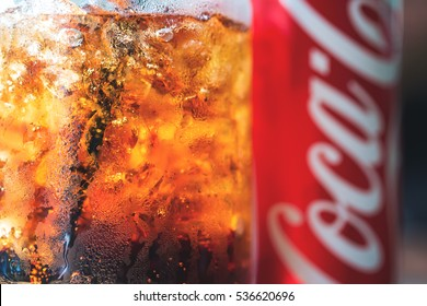 Chiangmai Thailand - DEC 14 2016 : Cocacola Coke can with ice in the glass on wooden table in cafe