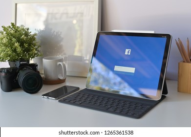 CHIANGMAI, THAILAND - DEC 23, 2018 : iPad Pro12.9 tablet new product of apple using facebook application on the screen.facebook is popular social network community.