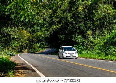ChiangMai, Thailand. December, 03-2017: People travelling in a car on road at countryside of Chiang Mai city surrounded by green lush.