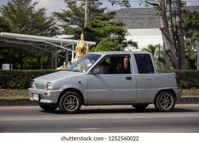 Chiangmai, Thailand - December 2 2018: Private Small city car, Daihatsu Mira. Photo at road no 121 about 8 km from downtown Chiangmai, thailand.