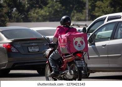 Chiangmai, Thailand - December 24 2018: Delivery service man ride a Motercycle of Food Panda. On road no.1001, 8 km from Chiangmai city.
