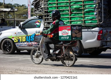 Chiangmai, Thailand - December 25 2018: Delivery service man ride a Motercycle of The Pizza Company. On road no.1001, 8 km from Chiangmai city.