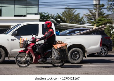 Chiangmai, Thailand - December 25 2018: Postman and Motercycle of Thailand Post. Photo at road no.121 about 8 km from downtown Chiangmai, thailand.