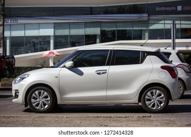 Chiangmai, Thailand - December 25 2018: Private Eco city Car New Suzuki Swift. Photo at road no.121 about 8 km from downtown Chiangmai, thailand.