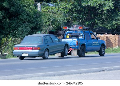 CHIANGMAI , THAILAND - DECEMBER 9 2014:  Prasert Yorn Tow truck for emergency car move. Photo at road no 121 about 8 km from downtown Chiangmai, thailand.