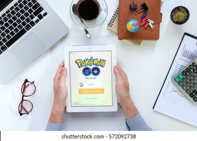 CHIANGMAI, THAILAND -FEB 05,2017:Man hand holding ipad 4 with busy page of popular app Pokemon Go