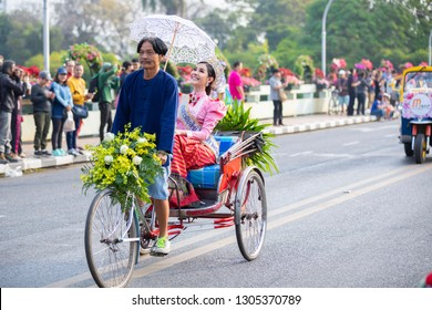 CHIANGMAI , THAILAND - FEB 2 2019: Young men and young women in costume taking part in an annual flower festival, 43 th Anniversary Chiang Mai Flower Festival 2019.