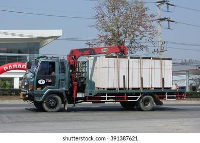CHIANGMAI, THAILAND -FEBRUARY 16 2016:  Truck with crane of STP Company on road no.1001, 8 km from Chiangmai city.