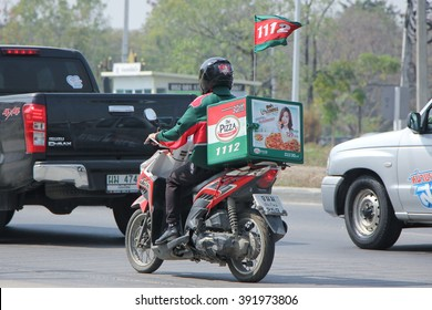 CHIANGMAI, THAILAND -FEBRUARY 19 2016: Delivery service man drives a Motercycle of The Pizza Company. On road no.1001, 8 km from Chiangmai city.