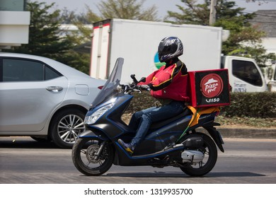 Chiangmai, Thailand - February 21 2019: Delivery service man ride a Motercycle of Pizza Hut Company. On road no.1001, 8 km from Chiangmai city.