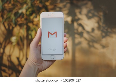 Chiangmai, Thailand - February 24, 2018 : hand holding screen short of Gmail app showing on iPhone6s . Gmail is free e-mail service provided by google.