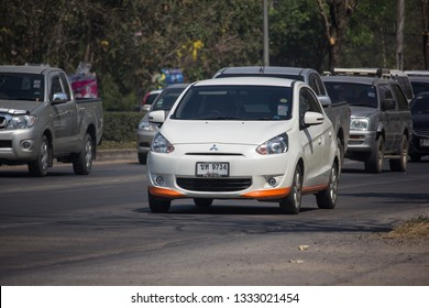 Chiangmai, Thailand - February 25 2019: Private Eco car Mitsubishi Mirage. On road no.1001 8 km from Chiangmai Business Area.