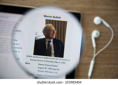 CHIANGMAI, THAILAND - February 26, 2015: Photo of Wikipedia article page about Warren Buffett on a ipad monitor screen through a magnifying glass.