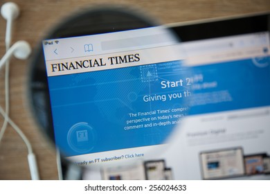 CHIANGMAI, THAILAND - February 26, 2015: Photo of The Financial Times homepage on a ipad monitor screen through a magnifying glass.