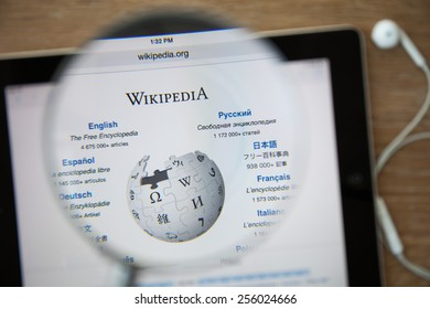 CHIANGMAI, THAILAND - February 26, 2015: Photo of Wikipedia homepage on a ipad monitor screen through a magnifying glass.