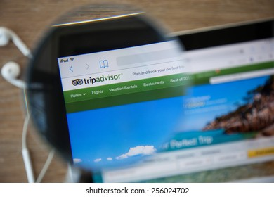 CHIANGMAI, THAILAND - February 26, 2015: TripAdvisor homepage through a magnifying glass.TripAdvisor.com is a travel website providing directory information and reviews of travel-related content.