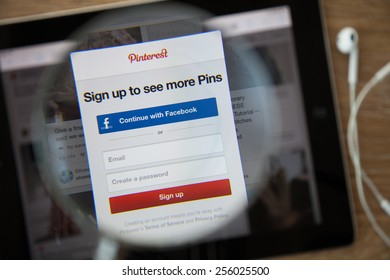 CHIANGMAI, THAILAND - February 26, 2015: Photo of Pinterest homepage on a monitor screen through a magnifying glass.