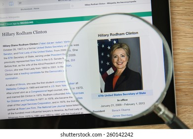 CHIANGMAI, THAILAND - February 26, 2015: Photo of Wikipedia article page about Hillary Rodham Clinton on a ipad monitor screen through a magnifying glass.