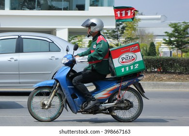 CHIANGMAI, THAILAND -FEBRUARY 27 2016: Delivery service man drives a Motercycle of The Pizza Company. On road no.1001, 8 km from Chiangmai city.