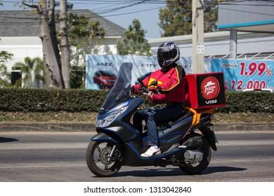 Chiangmai, Thailand - February 4 2019: Delivery service man ride a Motercycle of Pizza Hut Company. On road no.1001, 8 km from Chiangmai city.