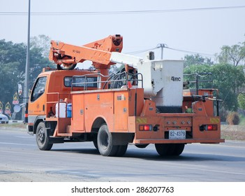 CHIANGMAI , THAILAND -FEBRUARY  9 2015:  Bucket truck of  Provincial eletricity Authority of Thailands. Photo at road no.1001 about 8 km from downtown Chiangmai, thailand.