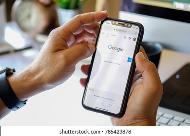 CHIANGMAI, THAILAND - JAN 02,2018 : close up on man hand hold iphone X for searching on www.google.com, iPhone X was created and developed by the Apple inc.