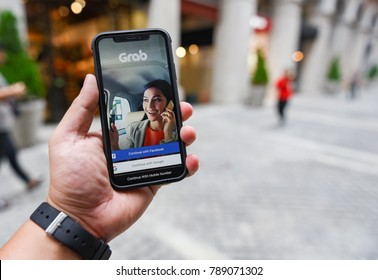 CHIANGMAI, THAILAND - JAN 08,2018 :Brand new Apple iphone X with GRAB application display on mobile screen in male hand's while he calling some