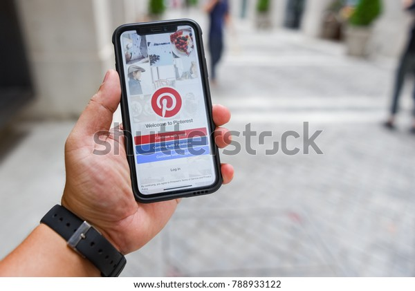 CHIANGMAI, THAILAND - JAN 08,2018 :Brand new Apple iphone X with social Internet service Pinterest on the screen. iPhoneX was created and developed by the Apple inc.